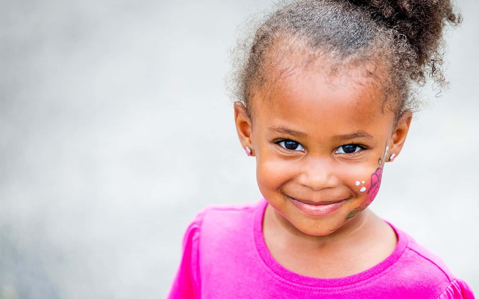 Little girl with facepaint on cheek