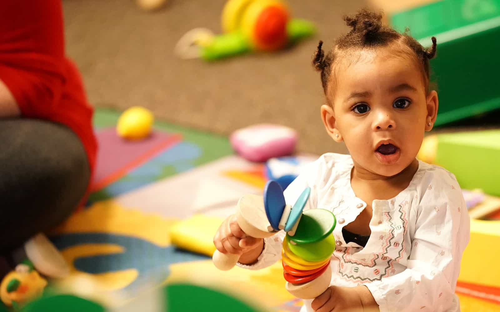 Baby girl playing with toy at Educare Chicago