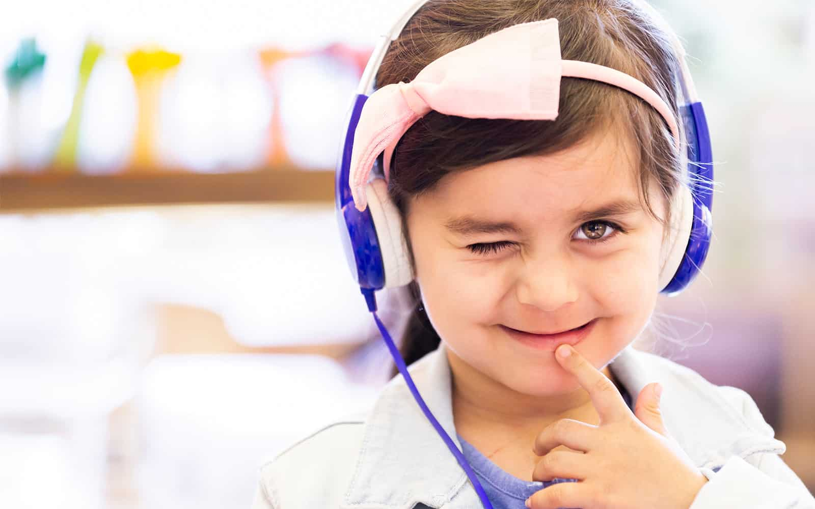 Child wearing headset winking at the camera