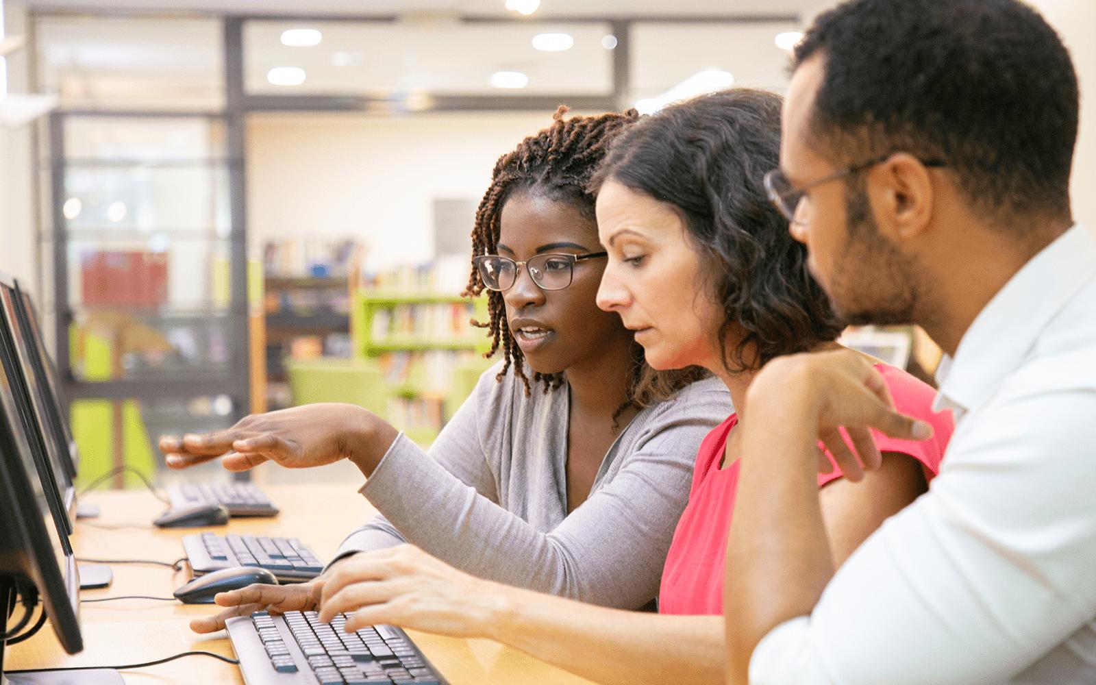 Professionals around a computer